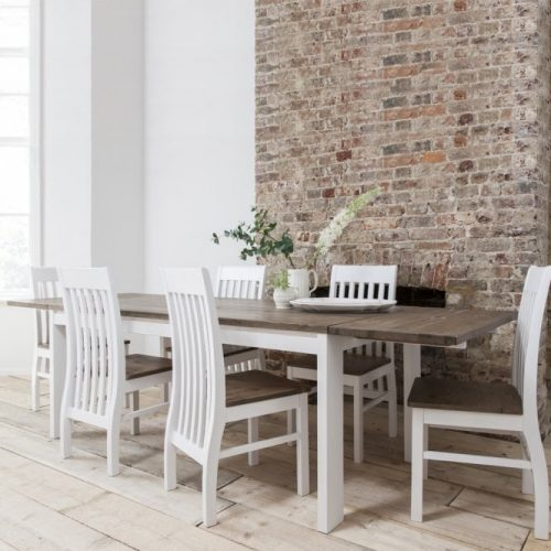 Long, 6-seater dining table with white, wooden chairs
