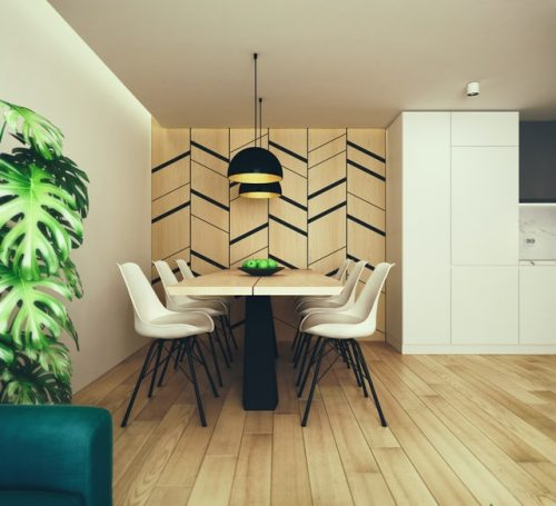 Dining room with a funky patterned accent wall and wooden flooring