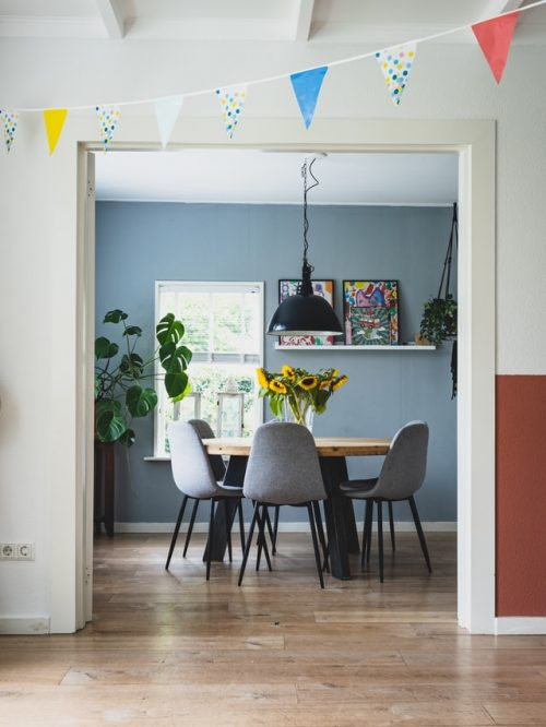Dining room with shelves holding artwork