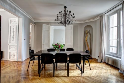 Stylish white dining room with a black dining table