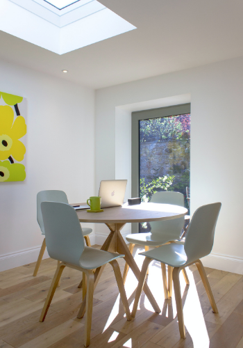 Spacious dining room with light grey dining chairs