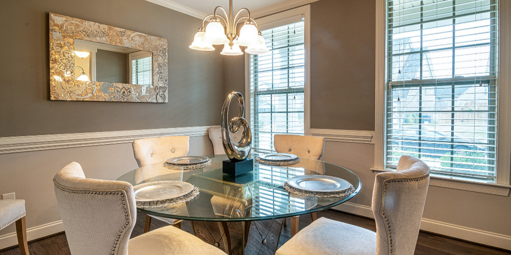 Elegant, grey dining room with metallic coloured accessories